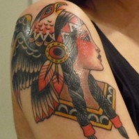 Coloured native american girl with eagle tattoo on shoulder