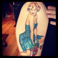 Coloured pin up girl with rose tattoo by Megan Hoogland