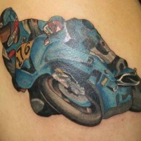 Coloured racer in bike tattoo on shoulder