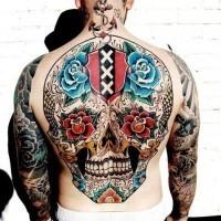 Coloured sugar skull tattoo on back