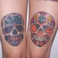 Coloured sugar skull tattoo on knees