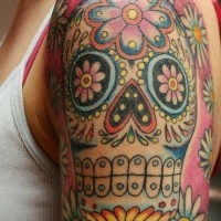 Coloured sugar skull tattoo on shoulder