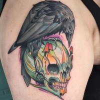 Comic books style colored upper arm tattoo of human skull with crow