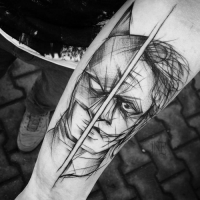 Comic books themed sketch style by Inez Janiak tattoo of Batman and Joker