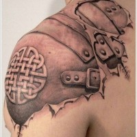 Cool armor with celtic pattern under skin rip tattoo