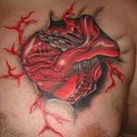 fresco cuore biomeccanico tatuaggio su petto