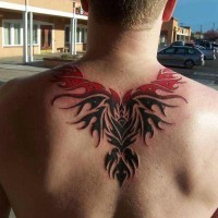 Cool black and red tribal phoenix tattoo for men