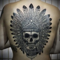 Cool black skull in an indian headdress tattoo on back
