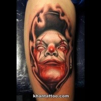 Cool cartoon style shoulder tattoo of maniac clown face