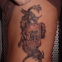Cool chinese tattoo with symbol and dragons on sidepiece