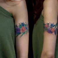 Cool colored arm band shaped tattoo of flowers