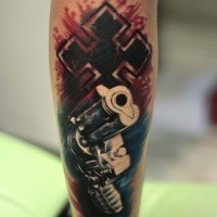 Cool combined and colored arm tattoo of big pistol and cross