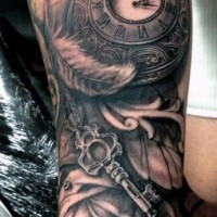 Cool designed black and white  old antic clock with feather and key tattoo on leg