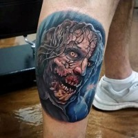 Cool detailed colorful monster zombie face tattoo on leg