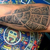 Cool eagle shaped black ink forearm tattoo stylized with tribal ornaments