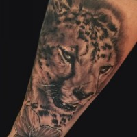 Cool gray-ink cheetah and flower tattoo on arm