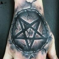 Cool illustrative style hand tattoo of stone demonic star
