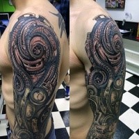 Cool looking colored lien like biomechanical hand tattoo on sleeve