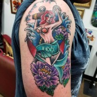 Cool looking colored mermaid tattoo on shoulder with various flowers and anchor