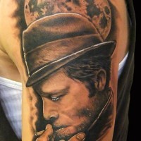 Cool natural looking colored smoking mafioso tattoo on shoulder combined with big moon