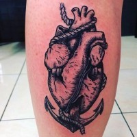 Cool painted black and white heart with roped anchor tattoo on leg