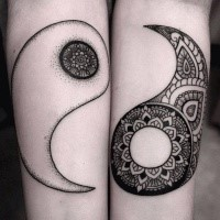 Cool painted forearm tattoo of Yin Yang symbol parts
