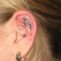 Cool simple butterfly tattoo on ear for her