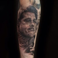 Cool very detailed black and white movie hero tattoo on forearm