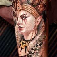 Cored incredible looking thigh tattoo of creepy clown with crown