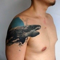 Creative designed and colored upper arm tattoo of large evil shark