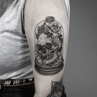 Creative designed dotwork style upper arm tattoo of human skull in bulb