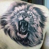 Creepy black ink scapular tattoo of roaring lion