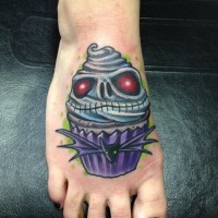Creepy colored cupcake designed with skull and bat foot tattoo