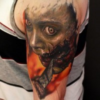 Creepy colored horror movie like bloody monster tattoo on shoulder