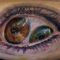 raccapricciante design terrificante  doppio occhio colorato tatuaggio su braccio