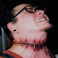 Creepy horror movie like colored neck tattoo of bloody stitches