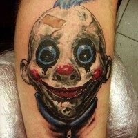 Creepy horror movie like colored smiling clown tattoo