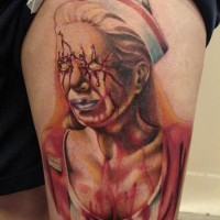 Creepy horror movie themed thigh tattoo of bloody monster nurse
