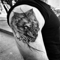 Creepy horror style painted by Inez Janiak upper arm tattoo of angry wolf