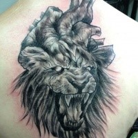 Creepy horror style upper back tattoo of roaring lion with human heart