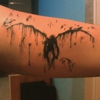 Creepy looking abstract style arm tattoo of demon