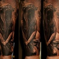 Creepy looking colored forearm tattoo of mystical woman with vine
