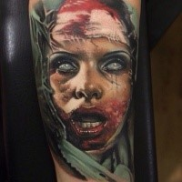 Creepy looking colored forearm tattoo of bloody monster woman