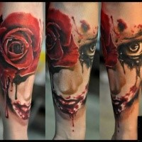 Creepy looking colored forearm tattoo of bloody face with rose