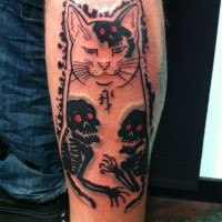 Creepy looking colored leg tattoo of Manmon cat with human skeletons