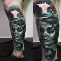 Creepy looking colored leg tattoo of woman portrait with small island and dolphin
