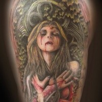 Creepy looking colored shoulder tattoo of bloody vampire woman with plants