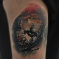 Creepy looking colored tattoo of evil Joker