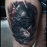 Creepy looking colored thigh tattoo of demonic woman with human skull
