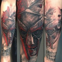 Creepy looking zombie gladiator warrior tattoo on forearm with old fight area